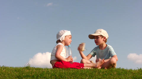 children with food on meadow Stock Video Footage