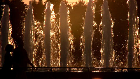 people and sunset fountain Stock Video Footage