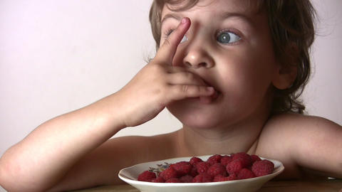 little girl with raspberry Stock Video Footage
