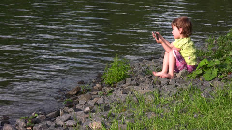 little girl on pond Stock Video Footage