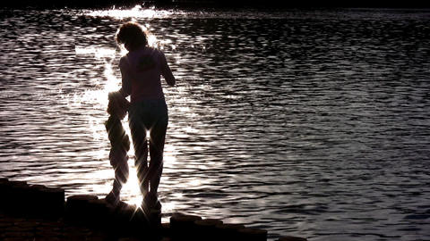 silhouette mother with child on water Footage