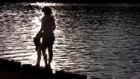 silhouette mother with child on water Stock Video Footage