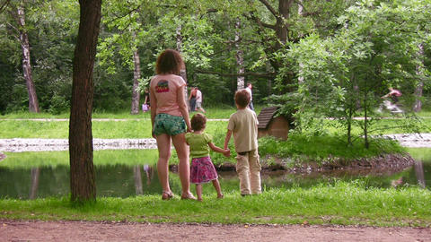 mother with children in park Stock Video Footage