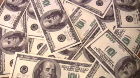count dollars in hands on dollar background Stock Video Footage
