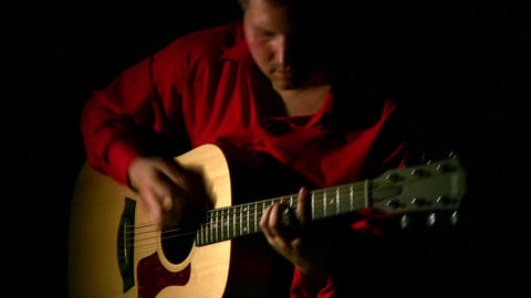 play on guitar in dark. Face Stock Video Footage