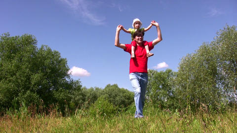 Daughter on fathers shoulders Stock Video Footage