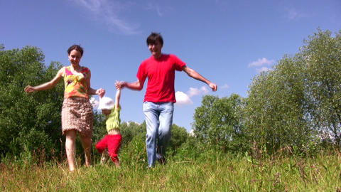 Family carry daughter in park Stock Video Footage