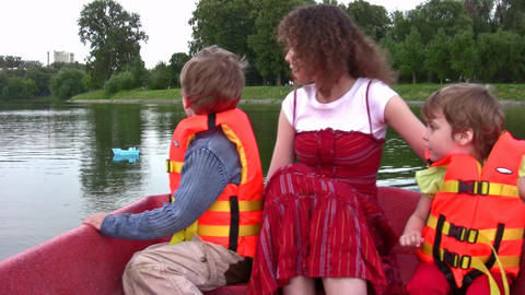 mother with children on boat Stock Video Footage