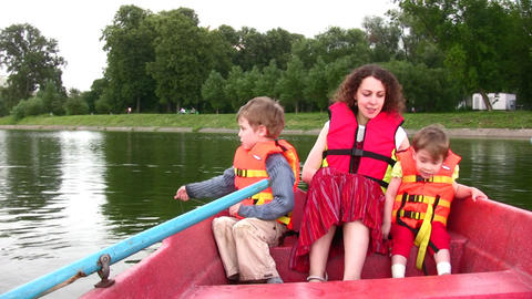 mother with children on boat 3 Stock Video Footage