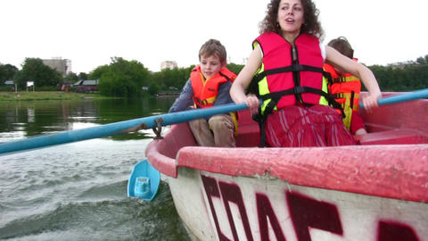 mother with children on boat 5 Stock Video Footage