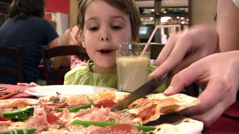 Mother with girl and pizza Stock Video Footage