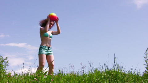 Woman with ball on grass Stock Video Footage