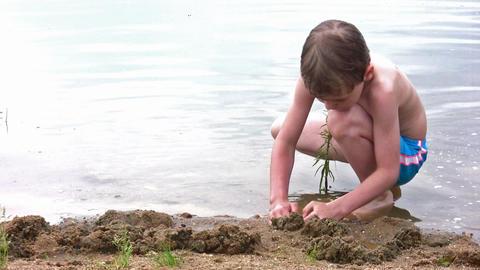 boy play sand on beach Stock Video Footage