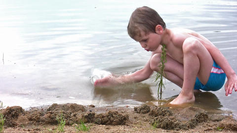 boy play sand on beach Footage