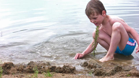 boy play sand on beach Stock Video Footage