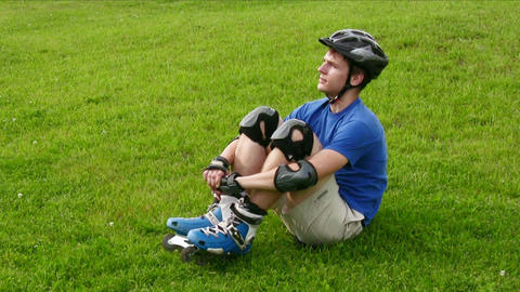 roller sit on grass Stock Video Footage