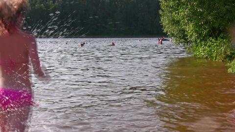 running splashing girl Stock Video Footage