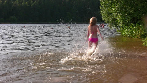 running splashing girl Stock Video Footage