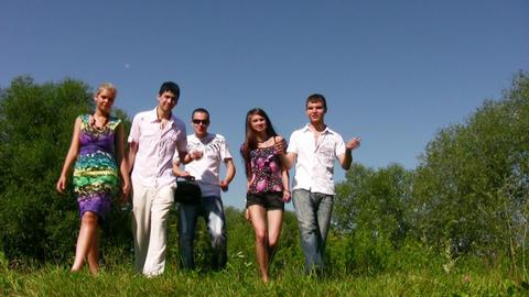 walking friends on grass Stock Video Footage