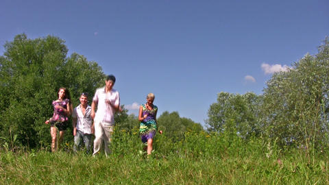 running friends on grass Footage