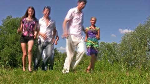 running friends on grass Stock Video Footage