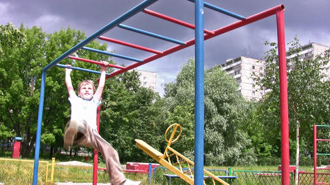 horizontal bar sport hang child Stock Video Footage