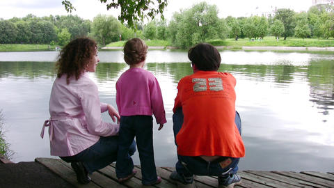 family on pond Footage