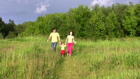 family with little girl running Stock Video Footage