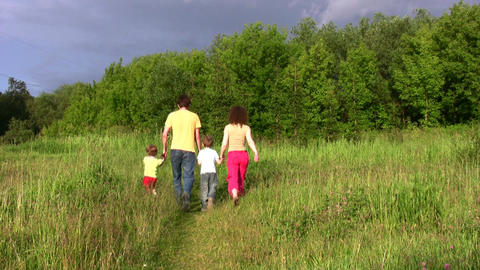 family of four in park Stock Video Footage