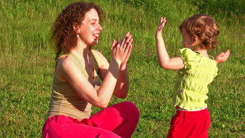 mother with little girl play hands Stock Video Footage
