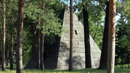 large granite pyramid in the forest Live Action