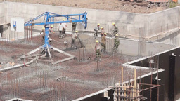 Workers on a construction site of new house Stock Video Footage