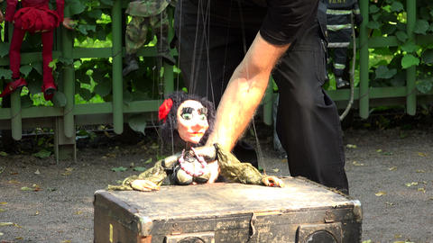 Doll a puppet on the strings. 4K Footage
