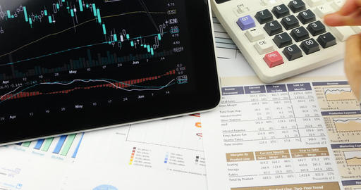 4k Businessman work on tablet with diagrams,finger touching finance pie charts Footage