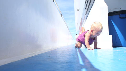 girl crawling on deck Footage