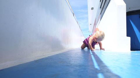 girl crawling on deck Stock Video Footage