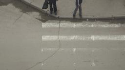 Pedestrians cross the street Footage