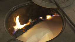Man burns papers into the stove Footage