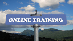 Online training road sign with flowing clouds Footage