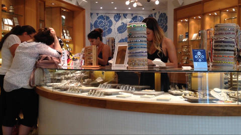 Friends shopping together in a jewelry store Live Action