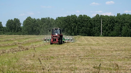 Agricultural Work In The Field Tractor Collect stock footage