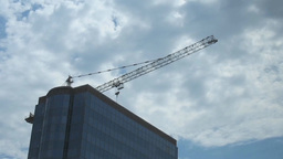 Top Of Skyscraper And Construction Crane Again stock footage