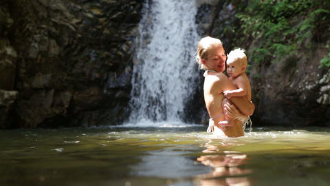 mom dive baby waterfall Footage