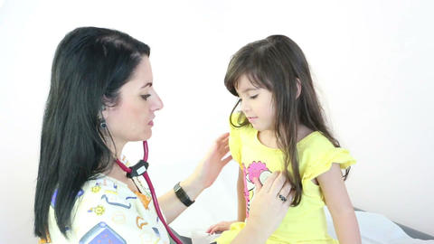 Doctor or nurse auscultating child patient spine w Stock Video Footage
