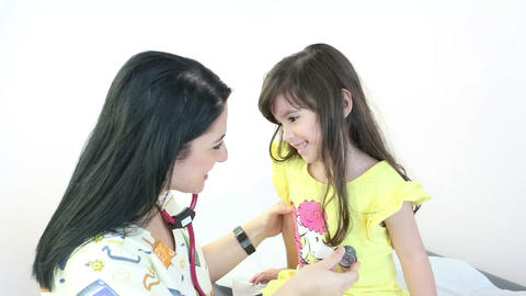 Doctor Or Nurse Auscultating Child Patient Spine W stock footage