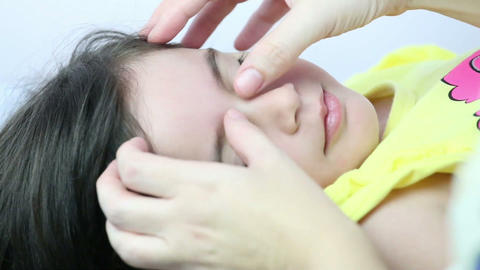 Therapist giving a massage in girls face Stock Video Footage
