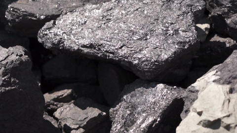 Carbon Graphite Ore Tilt Up stock footage