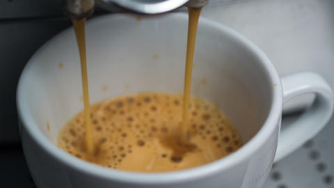 Coffee Machine Making Espresso into a Cap, closeup Footage