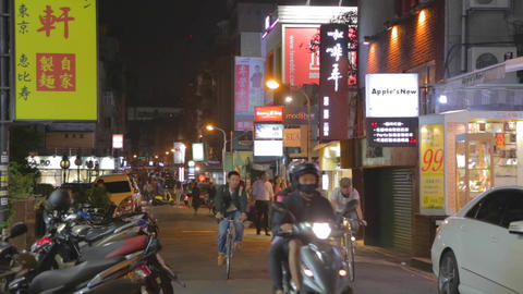 people ride bikes in hip Taipei district dunhua Stock Video Footage
