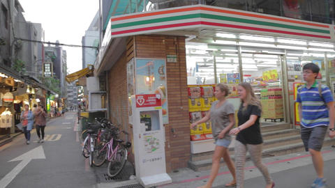 foreign students walk in shida lane outside 7-11 Footage